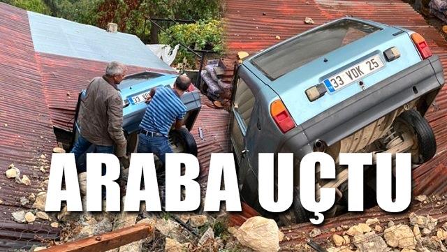 Araba çatıya uçtu